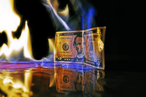 5106441340_558d48fb05_dollar-burning